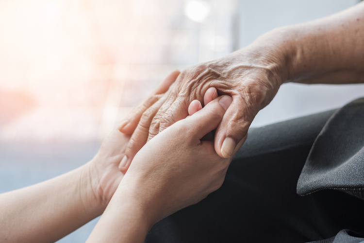 Parkinson disease patient, Alzheimer elderly senior, Arthritis person hand in support of nursing family caregiver care for disability awareness day, National care givers month, ageing society concept (Parkinson disease patient, Alzheimer elderly senio